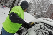 Brushing off cars for snow removal clients in Montgomery County, PA
